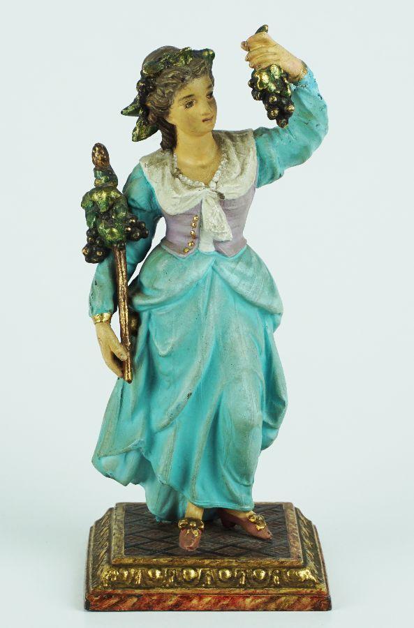 Figura feminina com uvas