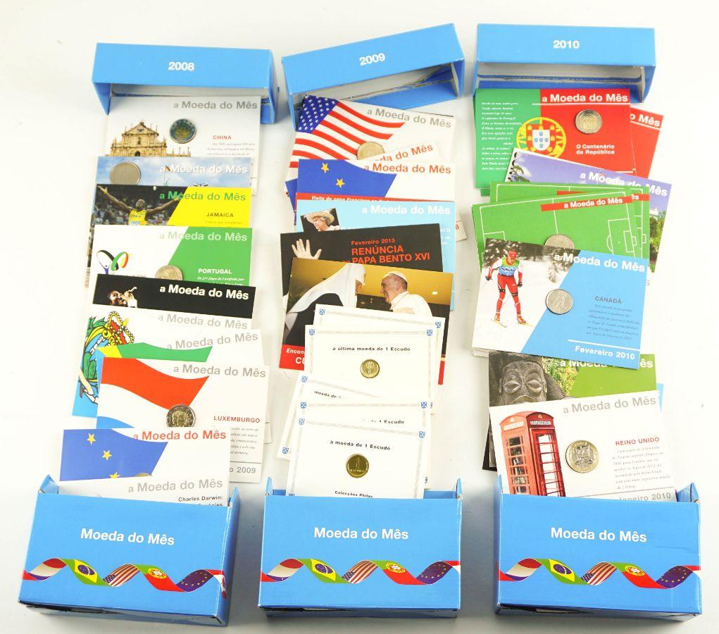 """Coleção de várias carteiras """"moedas do mês"""""""