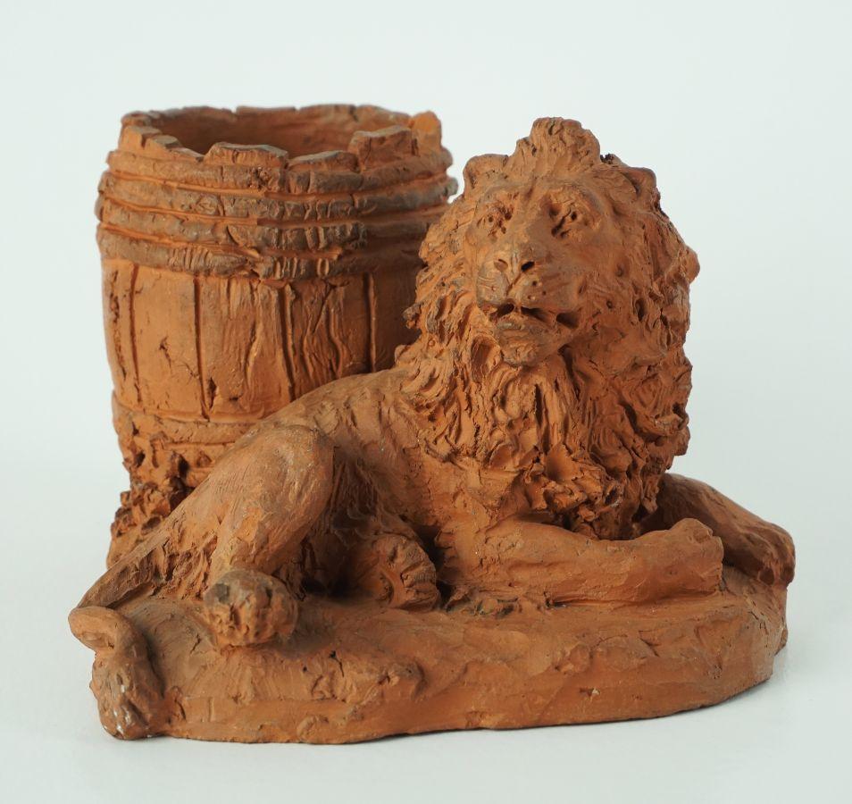 Leão com barril