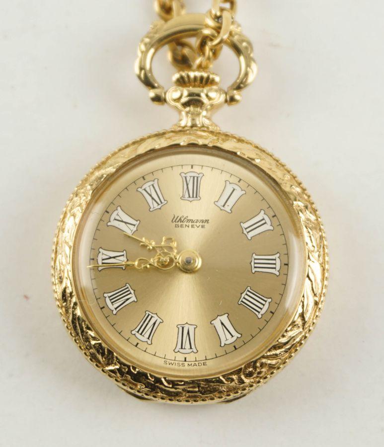 Relógio de lapela com corrente