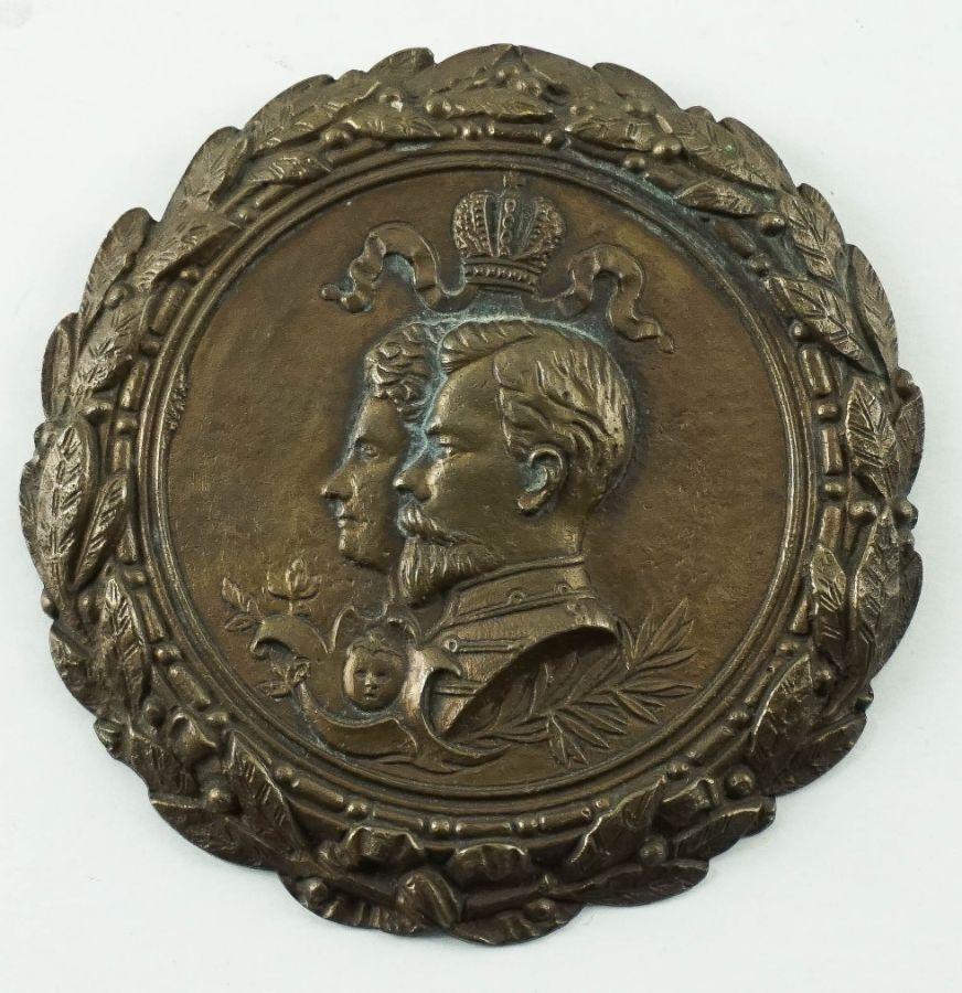 Medalhão de suspensão mural